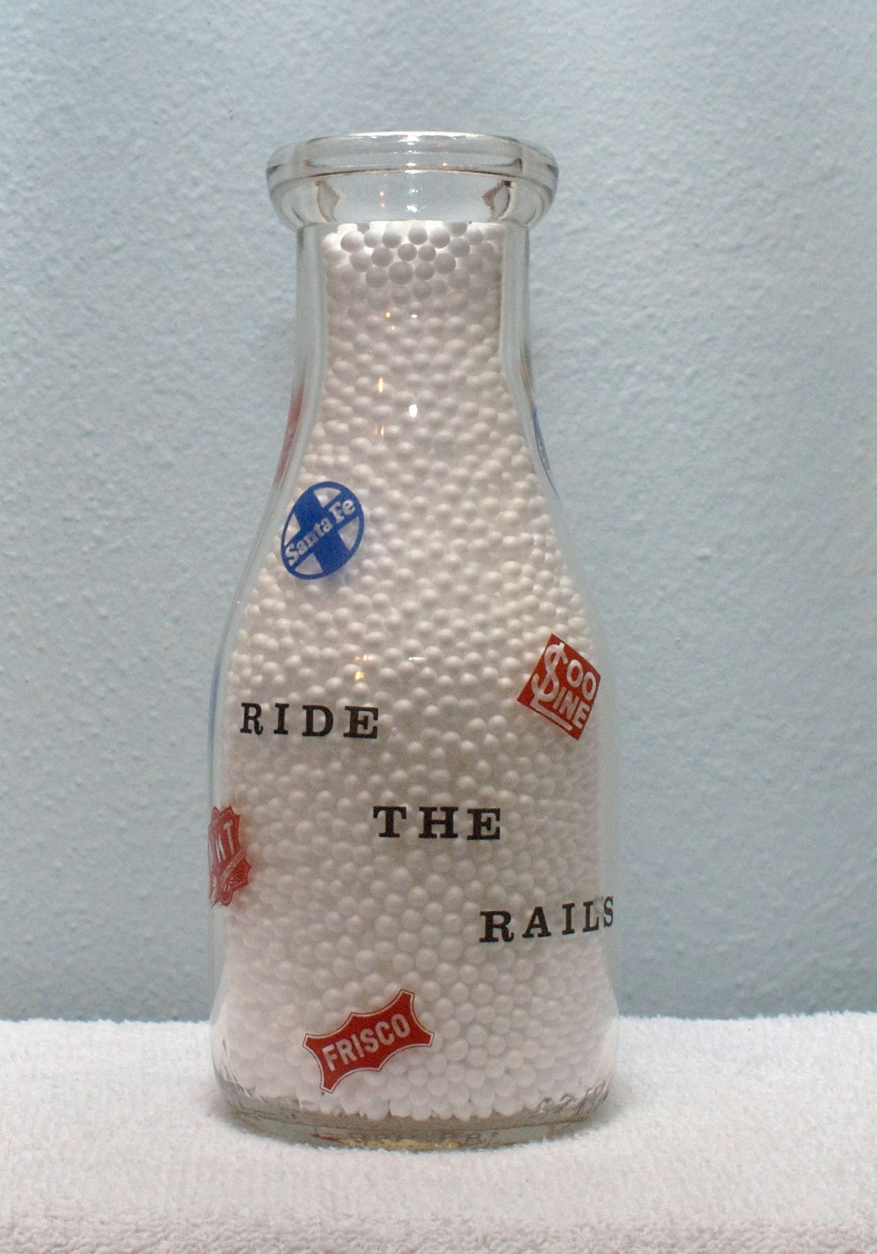 Limited Edition Page Milk Coffeyville Kansas Pint Milk Bottle 1940s back Ride the Rails