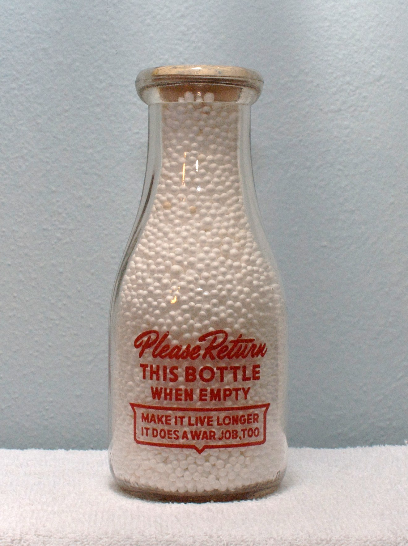 Pages Pint Milk Bottle Demanded for Its Quality Red logo back